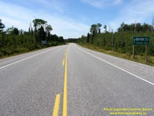 HWY 17 #1335 - © Cameron Bevers: A centreline view of Hwy 17 with a green highway guide sign at right, which reads Hwy 11 Hwy 17 West/Ouest Thunder Bay