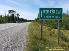 HWY 17 #1336 - © Cameron Bevers: A close-up view of a green highway guide sign, which reads Hwy 11 Hwy 17 West/Ouest Thunder Bay