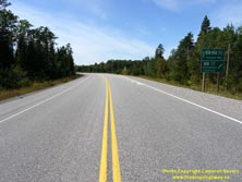 HWY 17 #1340 - © Cameron Bevers: A centreline view of Hwy 17 with a green highway guide sign at right, which reads Hwy 11 East/Est Greenstone Cochrane and Hwy 11 Hwy 17 West/Ouest Thunder Bay