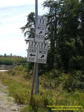 HWY 17 #1346 - © Cameron Bevers: A close-up view of a white highway junction sign assembly at Hwy 11 and Hwy 17 with cardinal directions and arrows shown