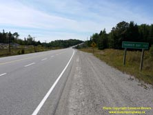 HWY 17 #1350 - © Cameron Bevers: A close-up view of a green distance guide sign, which reads Thunder Bay 112 (km)