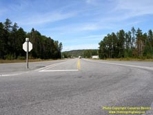 HWY 17 #1356 - © Cameron Bevers: A centreline view of Hwy 11 at the Hwy 17 Junction, with stop sign beside highway