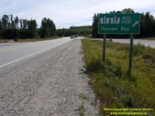 HWY 17 #1359 - © Cameron Bevers: A close-up view of a green highway guide sign, which reads Hwy 11 Hwy 17 West/Ouest Thunder Bay