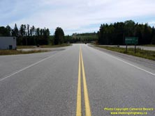 HWY 17 #1360 - © Cameron Bevers: A centreline view of Hwy 11 with a green highway guide sign at right, which reads Hwy 11 Hwy 17 West/Ouest Thunder Bay