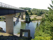 HWY 17 #1363 - © Cameron Bevers: An angled side view of the steel girder bridge over the Nipigon River on Hwy 11 and Hwy 17 with the ruins of the old concrete bridge piers at right