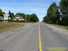 HWY 17 #1367 - © Cameron Bevers: A centreline view of Old Hwy 17 on an uphill grade heading out of Nipigon with houses and a motel partially visible at left