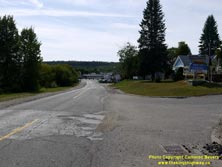 HWY 17 #1368 - © Cameron Bevers: An off-centreline view of Old Hwy 17 on a downhill grade heading into Nipigon with houses and a motel partially visible at right