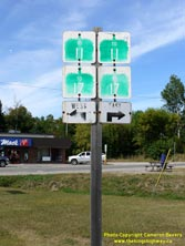 HWY 17 #1369 - © Cameron Bevers: A close-up view of a green trailblazer highway junction sign assembly for Hwy 11 and Hwy 17 with cardinal directions and arrows shown