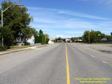 HWY 17 #1375 - © Cameron Bevers: A centreline view of Old Hwy 17 approaching a sharp horizontal curve with gravel shoulders and houses lining the street