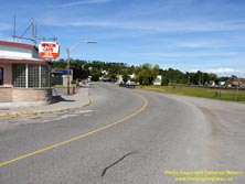 HWY 17 #1376 - © Cameron Bevers: An angled side view of Old Hwy 17 at a sharp horizontal curve with an old diner-style restaurant at left