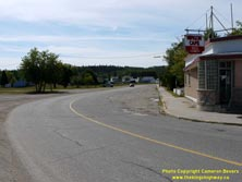 HWY 17 #1377 - © Cameron Bevers: An angled side view of Old Hwy 17 at a sharp horizontal curve with an old diner-style restaurant at right
