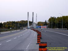 HWY 17 #1379 - © Cameron Bevers: A view of the new cable-stayed bridge over the Nipigon River on Hwy 11 and Hwy 17 while it was under construction from the future highway centreline. The new bridge is partially-completed at right while the existing bridge is at left. Various traffic signs and construction barrels and equipment visible.