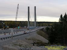 HWY 17 #1381 - © Cameron Bevers: An angled side view of the new cable-stayed bridge over the Nipigon River on Hwy 11 and Hwy 17 while it was under construction. General view of the construction site with various construction equipment and supplies visible.