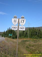 HWY 17 #1383 - © Cameron Bevers: A close-up view of King's Highway 11 and King's Highway 17 route markers and cardinal direction signs