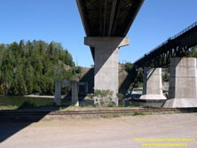 HWY 17 #1384 - © Cameron Bevers: A below deck view of the steel girder bridge over the Nipigon River on Hwy 11 and Hwy 17 showing the ruins of the old concrete highway bridge piers at left and the Canadian Pacific Railway Bridge at right