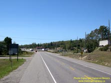 HWY 17 #1388 - © Cameron Bevers: An off-centreline view of Hwy 11 and Hwy 17 with commercial buildings and parking lots in the distance