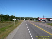 HWY 17 #1390 - © Cameron Bevers: An off-centreline view of Hwy 11 and Hwy 17 with a service station and other commercial buildings lining both sides of the highway